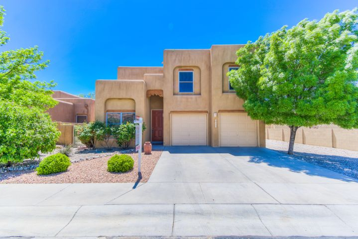 Gorgeous Southwest style Tiffany built home located in North Albuquerque Acres on a corner lot with amazing mountain and city views! Home features 2,646sf with 5 bedrooms, 3 bathrooms and a loft. Beautiful galley kitchen with upgraded cabinet space, granite countertops, stainless steel appliances and tile flooring. Separate formal dining. Grand living area with custom Vigas, a gas fireplace and updated flooring. 1st floor in-law suite with bath! Upstairs take advantage of the loft space, perfect for a home office.  Master suite w/ a plank wall, private balcony with stunning views and bath! Bath hosts dual sinks w/ granite countertops, relaxing garden tub, walk-in shower & walk-in closet! Fully walled backyard w/ covered patio w/ shade from mature trees! Hot tub included! Brand new plumbing