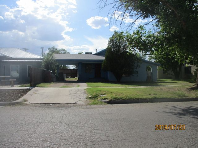 PRICE REDUCED!! This large home is located in the desirable heart of Belen.  Three bedrooms, two living areas, a great kitchen.  Walking distance to shopping, schools, etc.  Wood floors, large rooms. Needs TLC. Agents see LO/SO remarks.Property rented now need 24 hour notice