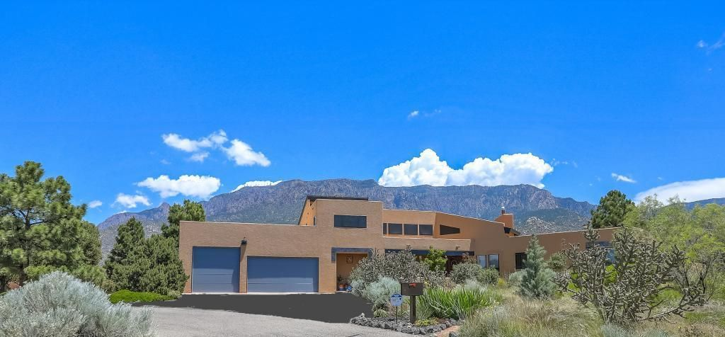 Completely remodeled, top to bottom. Unobstructed view of Sandia Mountains. Refrigerated air 2016. Twenty foot ceilings in main living area. Kitchen and all bathrooms remodel complete 2018. Solid hickory 3/4 inch wood flooring throughout house with porcelain tile in bathrooms, laundry and pantry. Custom tile work fireplace with kiva logs. Whole house humidifier 2016. Rubber membrane roof 2019.