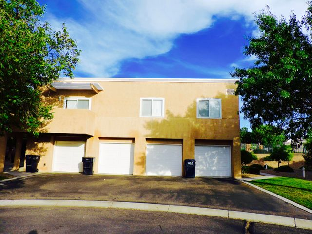 Wonderful 2 bedroom 2 bathroom condo in gated community by CNM, and El Oso Grand Park. It's move in ready and has been deep cleaned. NEW! washer & dryer, rang hood,  refrigerator and dishwasher. All appliances convey. Owner financing available.