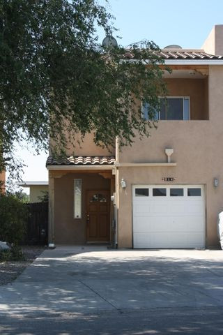 Stunning near new townhouse located minutes from downtown, old town and UNM. The downstairs has open floor plan, perfect for entertaining, kitchen offers lots of storage, nice island and upgraded appliances. The living room and dinning room open up to the covered patio outside inviting you to the enclosed garden. Upstairs has carpeted bedrooms, large baths and walk in closets. Attached 1 car garage and driveway.  New Carpet!  Price Reduction!