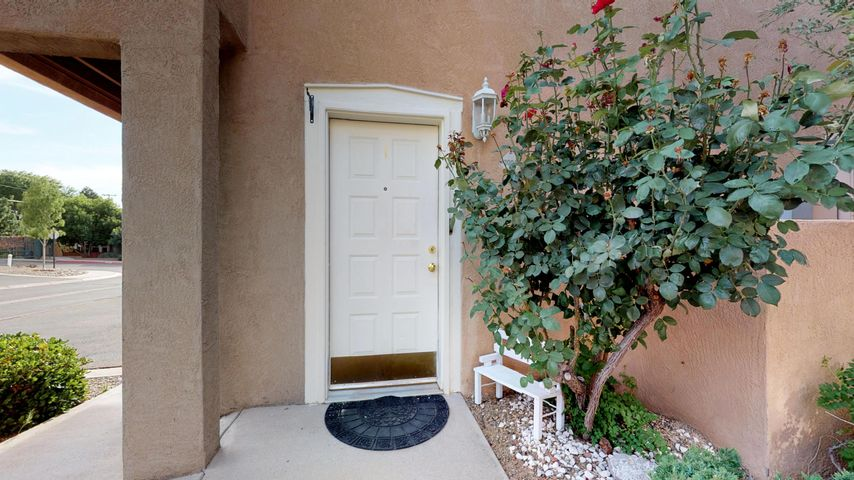 Beautiful 2 story condo in desirable gated NE Heights community. Single Car Garage! Open floor plan for kitchen, living area. Gorgeous laminate flooring. New dishwasher, new water heater, new carpet, and new paint.  HOA takes care of lawn, landscaping, water, security gate, exterior stucco, roof maintenance, etc... Move in ready! Come take a look today you will love it.