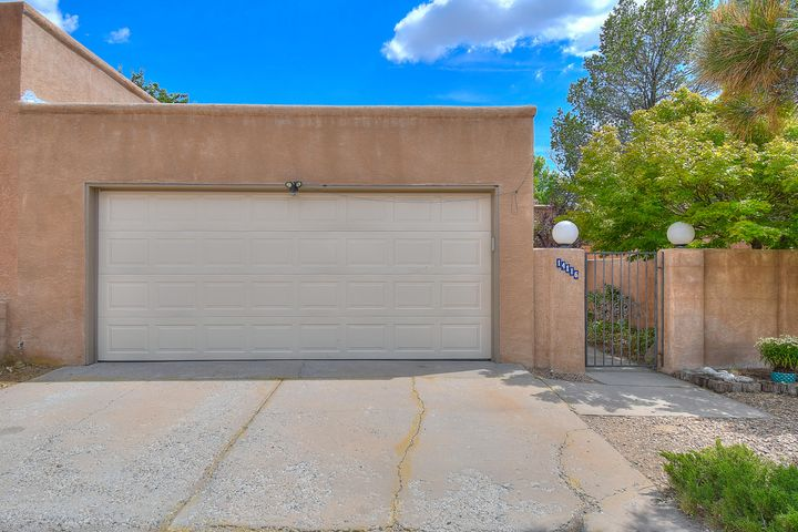This charming townhome down the street from a mountain trailhead is just the home you've been looking for. Located at the base of the Foothills, this updated charmer will captivate you as soon as you walk through the doors. With a kiva fireplace, high ceilings, and newer paint and flooring throughout, this place is turnkey. The bathrooms have been recently updated and the spacious master and low-maintenance backyard are made for easy living. All appliances convey, so you won't have to purchase anything. The front of the house has a charming courtyard for safety and appeal as you walk up. Easy access to I-40, shopping and restaurants. Don't miss your opportunity to own this great home with NO HOA and ready for its new owner to move right in. Call for your private showing today!