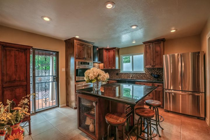 We know what you're thinking - THIS HOUSE IS INCREDIBLE!!! The fabulous floor plan is perfect for entertaining with first class interior design and remodeled touches using only the highest quality materials. This quiet and comfortable home features a stunning custom fireplace that partially separates the sunken living room from the elevated dining room. Set your inner chef free in the spacious kitchen or relax in the tranquil private backyard space. Don't wait to make this dream home come true for you!