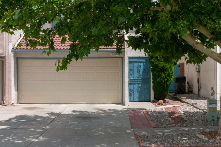 Wow! Very nice easy living Townhome in a convenient West-Side location. Quick access to Coors, I-40, Public Transportation, Shopping & Dining.  Great floor plan has an inviting entry, a large tiled living room with gas fireplace, tiled dining area and open kitchen. The 1/2 bath & laundry all downstairs.  Upstairs shows a BIG 19 x12 Master Suite w/private full bath, good closet space and personal linen closet.  Two more generous bedrooms upstairs and another full bathroom.  This Townhome has been updated with thermal windows, AC cooler, ceiling fans, some Light fixtures, both toilets, stacked stone F/P and more. You will appreciate the big covered patio with privacy blind plus a great 12x8 storage building. Two car attached garage. Close to everything, be the first to come see this one!