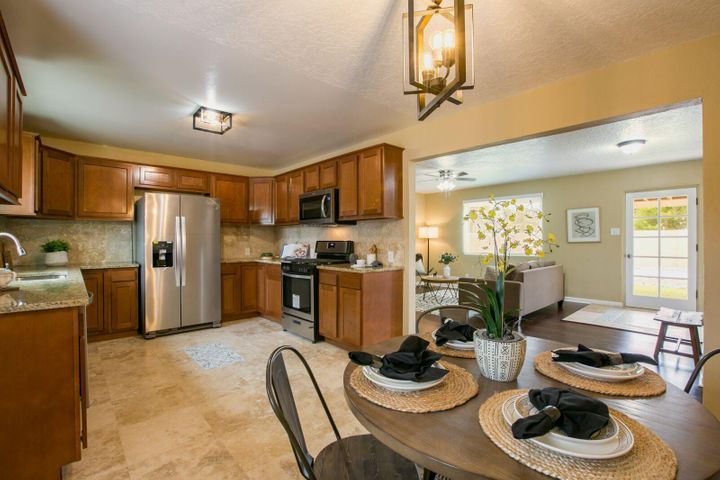 Open House Sat 11-3pm | Sun 12-2:30pm - Access Sandia View Rd Beautiful North Valley Home! Main house: 4BD, 2BA, possible office! Guest House: Separate Driveway, 2BD, 1BA, separate fenced backyard! Brand new appliances throughout. New Hot Water Heater and New HVAC for the Guest House!  Perfect for Airbnb or In- Law Quarters! Less than 5 minutes to Rio Grande Blvd, close to Sadies, Dions, Smith and Casa Rodena Winery.