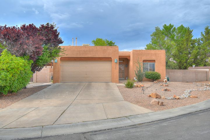 Extremely well cared for southwest style home in a great location! This home features gorgeous stained concrete floors in all the main areas, Santa Fe style design and trim throughout. Cozy up next to your living room fireplace in your large great room highlighted by soaring wood viga ceilings.  Kitchen features updated stone countertops and stainless steel appliance.  Outside you will find a large well manicured patio with serene water feature.  Extra large side yard big enough to make access for an RV or trailer.  Great westside location just close to Paseo Del Norte for easy commute.. A great modernized home with traditional New Mexican tastes. Schedule an appointment today!