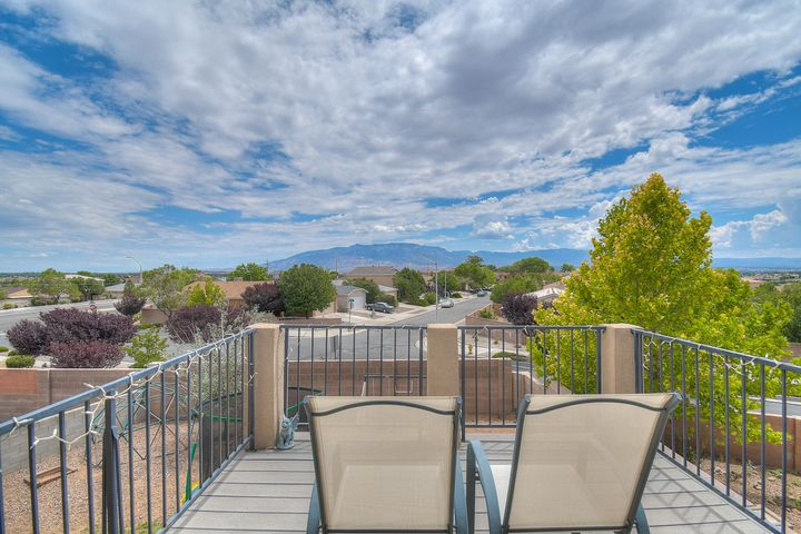 Welcome Home to this fabulous KB home with Amazing VIEWS of the Sandias from the Master Bedroom balcony! This spacious 4 bedroom, 2 3/4 bath PLUS a loft upstairs and 2 living areas downstairs. Located on a large Cul-de-sac with a walking path right out the front door.  Step inside to the warm wood laminate floors to the living room which wraps around to the cooks kitchen and to the family room with built in entertainment center.  Enjoy the comforts of REFRIGERATED AIR!  This home has so much to offer.  Carpet to be replaced at closing with an acceptable offer.Schedule your showing TODAY!
