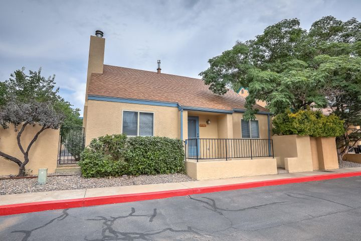 You will love this updated townhome!  Great location, two car garage, newer carpet, master cool cooler, roof, counter tops, fresh paint inside and out, wood burning fireplace, master suite on the main level, nice courtyard, new vinyl clad windows with lifetime warranty for $50 transfer fee, newer water heater, close to movie theater, schools, grocery store and easy access to I-40 Move in ready!  Freshly and professionally cleaned