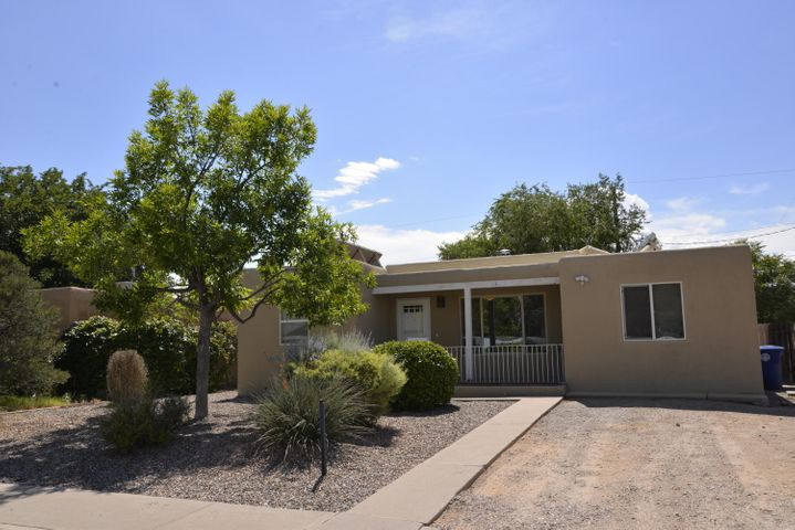 Back on the market, inspections completed.  Welcome to 1209 Hermosa Dr. SE.  This 2/3 bedroom home sits close to KAFB, Sandia Labs, VA, Nob Hill and UNM.  Located in an established neighborhood.  The home features refrigerated air, hard wood floors, tiled kitchen, GE appliances, large walled back yard.  Back yard features a separate deck perfect for entertaining.  The home offers a 3rd carpeted room which can be used as bedroom, office, tv room, home gym or 2nd living area.  The 3rd room has a potential separate entrance.  Solar on the house once heated the water heater is deactivated.  Seller is also including separate deed to North lot of the home with purchase.