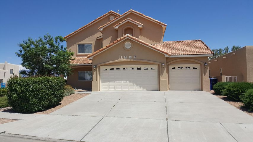 OPEN HOUSE SAT & SUN 8/10-11 NOON TO 4PM.Custom built Scottsdale style  home with  great views of the Bosque, Sandias & city lights in  desirable Paradise Bluff  adjacent to The Petroglyphs.  House features  include: corner premium lot fully landscaped with  walled BY  enclosing wrap around  covered  patio, 2x6 Const, 9 Ft Ceilings, Tile, Carpet & Hardwood floors, 2 FP, central vac, 2 living areas, separate DR, Italian Granite  counters  + island with sink & breakfast bar in gourmet kitchen opens to Family Room, surround sound, indoor & outdoor ceiling fans, Kitchen  & Patio  Steel security screen doors, Re-circulating Hot Water, Lg 3 car garage, Pitched Tile Roof.  All 4  BR located upstairs. Master BR has its own   deck to relax & Private SPA bath  w/huge 10x6.9 dressing room! A must see
