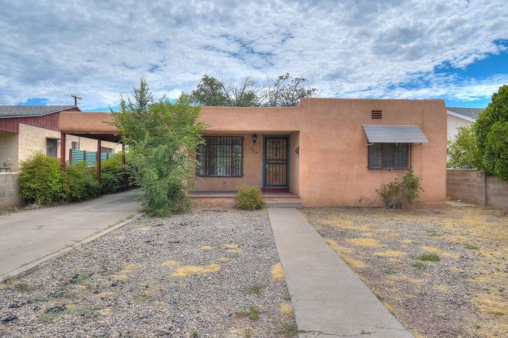 What's that sound? Opportunity is Knocking! This home is great for a creative eye that's looking for a place with great potential. When you visit you'll notice how convenient this home is to local shops, great restaurants and UNM! As you walk through, you'll notice how spacious the 2 living areas are and how you can update this gem to make it really shine! The skylights bring in the maximum amount of natural light. The unique floorplan gives plenty of options to indulge your creative side. This home is full of character and has original hardwood floors! Don't wait on this one, seize this opportunity, Today!