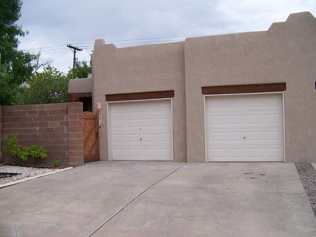 Wonderful home in a low traffic area close to the Heart Hospital, Del Norte H.S. and the San Mateo/Montgomery business corridors.  The unit has new tile flooring and radiant heat piping.  Greatroom has a gas fireplace and built-in bookshelves.   Refrigerated air!  Newer roof.  Both bedrooms have large walk-in closets.  Oversized garage with storage and room for a workbench.  East facing covered patio to enjoy shady evenings.  Artificial turf area off the patio with trees and shrubs.