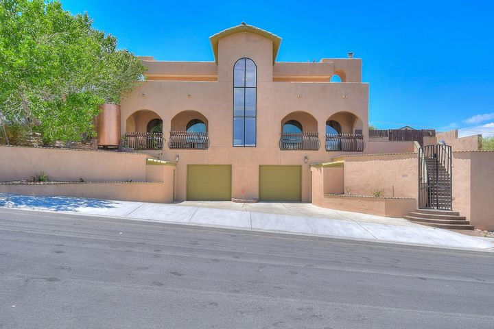 Tuscan style 3 level custom home with elevator (installed in 2018) New roof 8/2019 with 6-year warranty, Amazing views from 1,000 sf master suite on top level. Master suite features exterior patios from bedroom and bathroom. Master suite  also features coffee bar. Romeo & Juliet balcony is great place to sit and enjoy the view. The gourmet kitchen is sure to please the cook! Custom knotty alder cabinets throughout. Two wood burning custom fireplaces, office area, 60'' stove installed in 2018. Remodeled Over sized shower and jetted tub in master bath. Two walk-in closets. Brick flooring and dramatic foyer entry make this home a must see! Close to hospitals, schools, shopping, restaurants and public transportation. Great home for multi-generational living. Open floor plan, tons of storage!