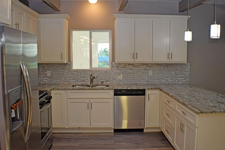 NEW NEW NEW this great home in established neighborhood completely remodeled. New stainless steel appliances, new faucets, new flooring, new lighting, new refrigerated air throughout. Kitchen features white cabinets with granite countertops and gas range. Four bedroom with office that could be used as additional bedroom. Walk in shower in master bath, hall bath has bathtub and additional powder room off of living area.  Open floor plan with large living room and dining area and do not forget about the bonus room.  Large two car garage attached to the home with separate one car or workshop in back of property.  You have one acre to park your rv or boat. This home features 2800 sq. ft  of living space make an appointment today!