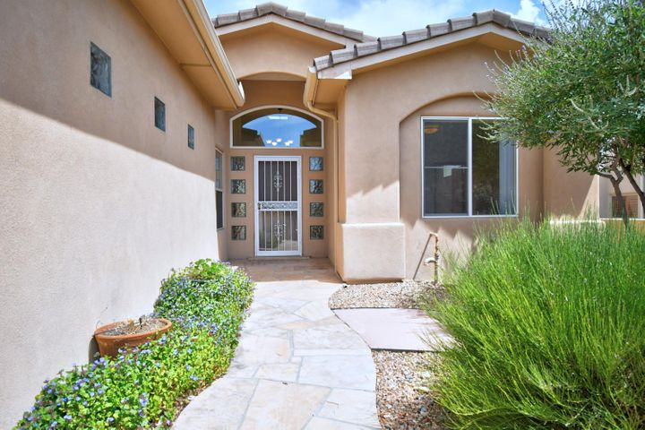 This gorgeous single level home has been updated with new porcelain tile floors, premium granite counter tops, and appliances. Remodeled powder room. Upgraded power blinds open and close with a  push of a button. Great Sandia mountains views inside and out. Welcoming private courtyard with gate leads to  a very wide open floor plan. Great room, dinning room and kitchen all open to the views!  Radiant heating for warm toes in the winter. Two master coolers. Unique floor plan with double master bedrooms.  One has private entry to back patio and excellent views of mountains, other could be a great art, home gym, studio or fabulous nursery.  3 car finished garage with storage. Backyard has covered patio with flag stone and beautiful flowers. Close to hiking and biking trails.  Virtual staging.