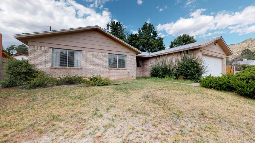 Tons of potential for this ideal 3 bedroom, 2  bath home. Retro kitchen. Large backyard with established trees. Great location!