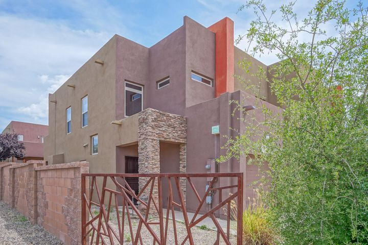 OPEN SUNDAY 2-4 Aspire Domingo Baca end unit. STUNNING! Elegant stacked rock entry in to fabulous floorplan. High ceilings with beautiful arches, large family room with fireplace adorned in light. Gracious open kitchen and dining, luxurious Master Suite with private deck and mountain views. All bedrooms are spacious with 3rd bedroom being an excellent home office if desired. Immaculate, practical, sophisticated living in a convenient location. Minutes to I40, Restaurants, high- end shopping, schools, and parks. Live in cosmopolitan style! A polished ready- to- move- in masterpiece at an amazing price.