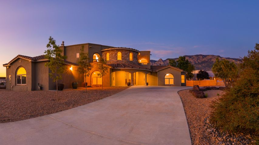 Magnificent custom built Tuscan style estate, situated perfectly on a large.89 property to enjoy those stunning mountain views! This luxurious home hosts 5,978sf, 5 bedrooms, 3.5 bathrooms, 2 living areas, an office, 3 car garage and a RV pad! Beautiful foyer entry with grand staircase. Stunning living area with built-in media center, soaring ceilings with wood vigas and a wall of windows showcasing the views. Designer kitchen with custom cabinetry, granite countertops, stainless steel built-in appliances, hand painted center island, pantry and high top bar w/ seating space. Private 2nd floor master with sitting area, 2-way fireplace & a wrap around balcony w/ views. Additional guest room perfect for a nursery or office. Gated backyard access w/ RV parking!