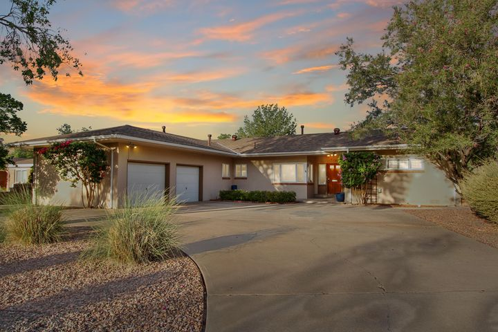 Grand, Marvelous, Exquisite just a few words to describe this lavish ranch style 3 bed, 3 bath home. The captivating vaulted ceiling with beams & luxurious hardwood floors are just a small taste of the detail of this beauty. Enjoy company in cozy eating nook or formal dining area which could be an office or study area. Large separate utility room! Relax by the beautiful gunite pool (with automatic cover!) & enjoy the gentle breeze in the outside living area. Keep all your garden implements for your landscaped yard in the finished garage. With newer roof (transferable warranty!), refrigerated air, & new sewer line means low maintenance. This location has easy commute to hospitals, UNM, VA, KAFB, Sandia Labs, Nob Hill, parks, schools, shopping & airport.