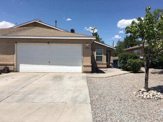 This adorable home is close to Kirtland Air Force Base, Sandia Labs, schools and transit. Amazing open floor plan, vaulted ceilings, separate dining area and low maintenance yards. This is a must see!