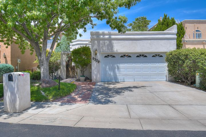 Gorgeous single-story home located in the exclusive Tanoan community with southwest flair! Positioned perfectly to enjoy all of the amenities that Tanoan community has to offer. Walk up to an enclosed gated picturesque courtyard to front entry to be immediately greeted by captivating saltillo tiles, high ceilings, and massive vigas. The open floor plan encompasses three spacious bedrooms. Extended entertaining spaces flow outside to the green and quaint backyard with mountain views.  Noteworthy features include kiva fireplace, nichos throughout, and a master suite with patio doors that lead you to the impressive backyard. Schedule a showing today!