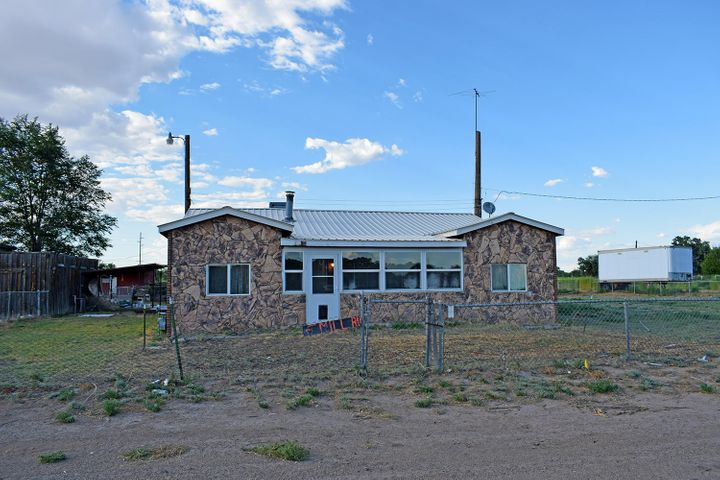 This one needs a little tlc and will make a wonderful property for you and your horses with pipe fencing. Roping arena with shoot and run back alley. 7 covered stalls, 20x16 tack room. Barn/Garage 27x37 has separate electric meter with 220.  RV hookup with water and electric behind home.  The home has 4 bedrooms and 2 baths original wood floors in living area of home with T&G ceiling.  Large eat in kitchen and large laundry/pantry.  Newer windows, furnace 2 years old, this home is sold as is but is currently livable while you work to make it your own.