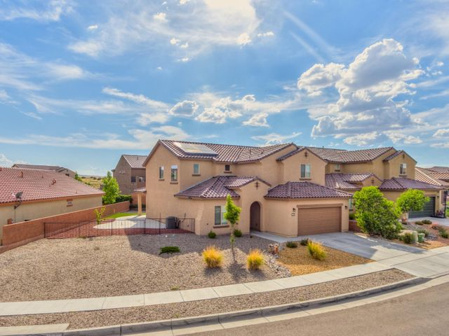 Come and see this popular Pulte home located in the Boulders community! This 6 bedroom, 4 full bathrooms home has 2 living areas with a huge loft! The master bedroom is located downstairs with a nice spa like full bathroom with upgraded double bowl sinks. The main living area opens up to the kitchen that boast a huge granite countertop island with a huge farm style drop down sink. Upstairs features another HUGE loft / living area that has plenty of room for a second living room AND game room.  With 4 additional bedrooms upstairs it is like a whole other home.  The low maintenance back yard is complete with turf grass (easy maintenance) and additional storage shed.  Come and see this one before it's gone!!!