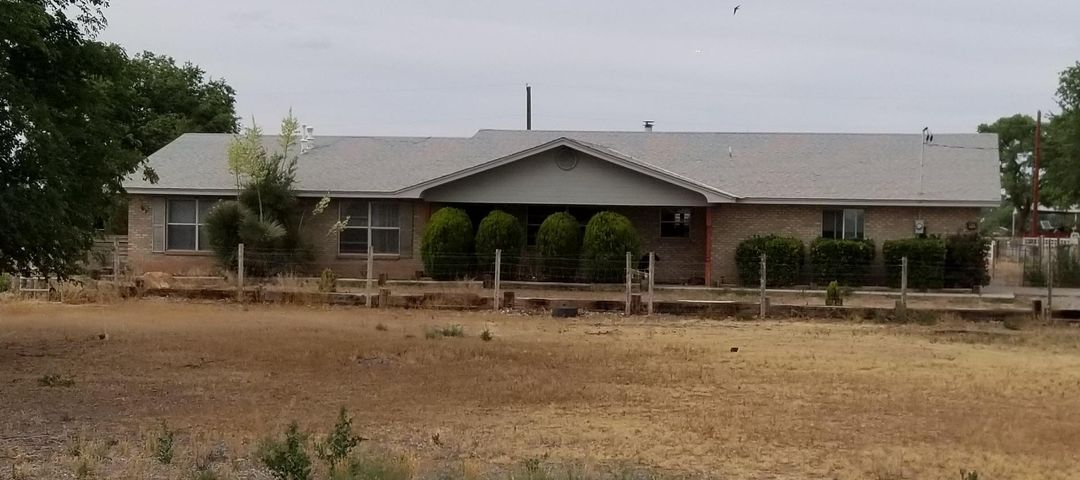 Historic Tome horse property on 3.61 acres of which 2.55 is adjudicated Pre-1907 water rights. This alone could mean $40,000-$60,000 in value for your buyer. The 2277 Sq ft brick ranch has tongue and groove ceiling in the living room, an insert wood fireplace and formal dining room. The oversize garage has plenty of storage. A 5 stall block barn with tack room, a round pen and arena and pastures complete this property with beautiful views of Tome Hill and the Manzano Mountains. The owner works long hours and needs a 24 hour notice for showing. Sunroom is heated and finished and included in the living area. New laminate flooring in living room, dining, hall & master.