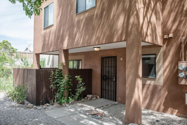 Welcome home to this beautiful condo in the Paradise area! Newer Carpet and laminate wood flooring, newer paint, cozy fireplace, separate laundry room, downstairs has guest bathroom for convenience, sky lights for natural lighting, fenced in private patio,  3 roomy bedrooms, double sinks in upstairs guest bathroom, master suite is spacious with 3/4 bathroom and 1 car garage, ALL APPLIANCES STAY! Great location! Close to Cottonwood Mall and just minutes away from Paseo Del Norte. Schedule your showing today!