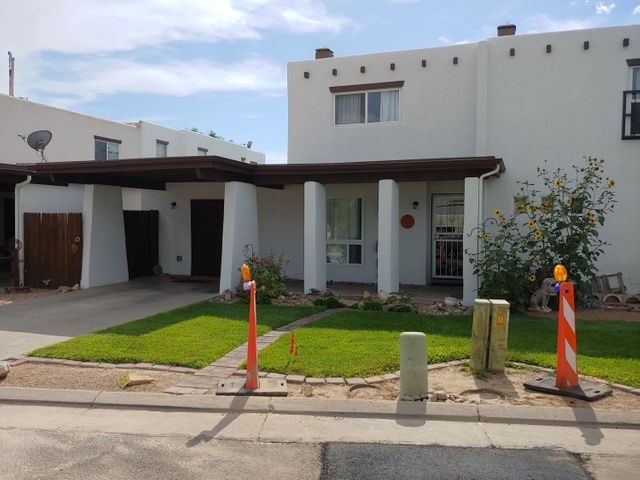 Must see this Double Master townhome in one of the best value communities... a hidden jewel! Two story home has a master down and one up, three bedrooms all the same size plus a loft. Tile everywhere downstairs except Bedroom, beautiful courtyard open to kitchen and dining...tons of light drenching the kitchen and dining. This is an amazing value for such a nice plan and layout. Community pool and community storage facility for RV's other vehicles. $135 HOA covers water, sewer, refuse, and front yard mowing. Lots of updates including refrigerated air, Tankless water heater, vinyl windows, baths, cabinets...move in ready.
