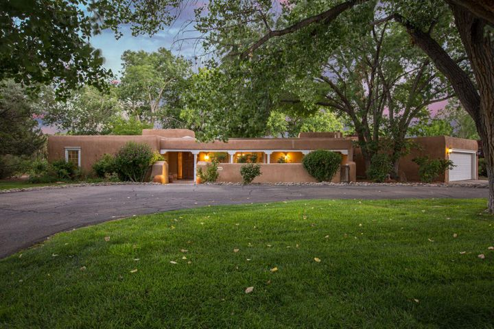 Lovelyupdated home under giant cottonwoods.Incredible low maintenance pool and outdoor kitchen create the WOW factor for this charming pueblo in highly sought after Caballero South.  Updated stone bathrooms, huge master with fireplace and large walk-in closet,granite/stainless kitchen.  Hardwood floors added in the bedrooms and living room.  Radiant heat with newer air conditioners, one with heating too. Guest house with large bath, adjacent to outdoor living with fireplace and grill. Wood beamed  ceilings, book-lined family room with tall ceilings,sunroom and bar area.  Recent roof (2012). Almost 3/4 acre lot allows for development of play area or other outdoor space behind the outdoor living area.  Hard to find homes with these amenities in this neighborhood. Easy to show!