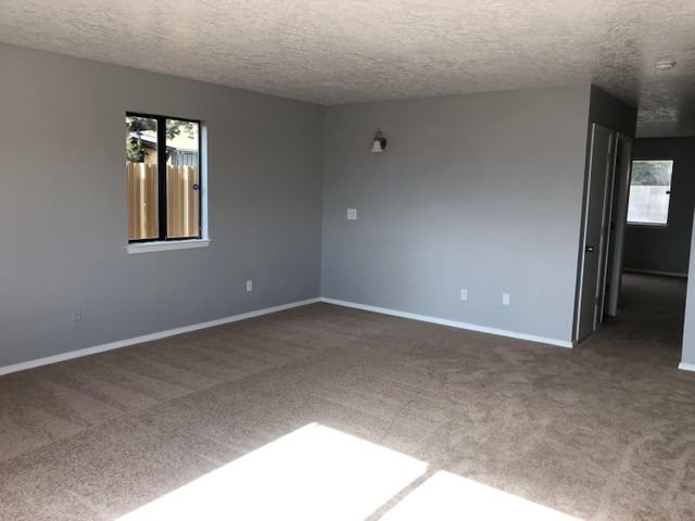Need more Room?  This beautiful updated 4 bedroom, 2 3/4 bath townhouse has it.  New Flooring Carpet & Vinyl, Fresh Paint, New Countertops, New Garage Door and more.  Home has living room, dining room, breakfast nook, good size bedrooms, large utility room and 2 car garage.  Easy access to I-40.  A lot of home for the money!Dishwasher and stove to be installed