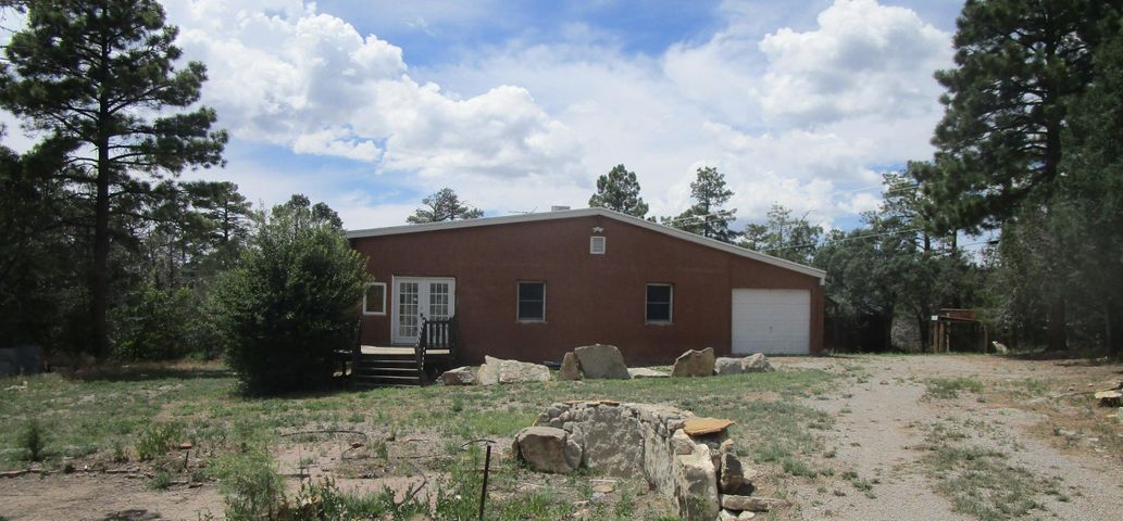 Cabin Style Home With Open Floorplan!  Super cute mountain home! This 1 bedroom 1 bath home needs a new owner! Dining/living combo and open kitchen! Home is nestled in the Sandia Mountains! Great views and not to far out of Albuquerque!