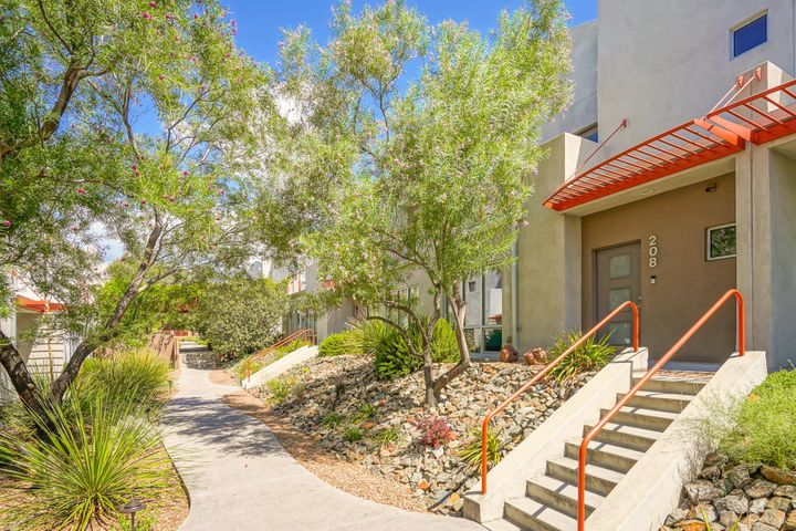 Located in historic prestigious Nob Hill; ABQ Sunport, the city's best restaurants and shopping and three major hospital medical centers are minutes away. Immaculate contemporary townhome, first floor invitingly open, perfect for entertaining, with a guest half bath off the entry hall.. Split bedroom plan upstairs, private master suite on one end, including bath with soaking tub, double sinks, glass door shower and a terrific custom California Closet. Two additional bedrooms, full bathroom and laundry/ utility room with storage closet open onto the wide upstairs gallery style hallway.  Low maintenance, easy care tile floors downstairs, hardwood floors above. There are granite countertops throughout, in the kitchen and both upstairs master bath.