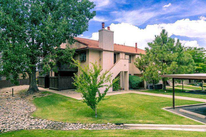 Rare opportunity in the NE Heights for a condo under $100,000!  Established community with mature trees and abundant lawn (that you don't have to mow!) and an inviting community pool/hot tub and club house.  Close to Academy and San Mateo with delicious eateries, shopping and entertainment, plus quick access to I-25 for easy commutes...all from within a quiet community with designated covered parking.  This beautiful ground level unit offers an open floor plan, ref air and a private, covered patio.  All appliances stay so you're able to move right in!  Enjoy your own laundry room with additional storage and a full bath with tile tub surround.  Premiere location in the community with no units to the west and guest parking conveniently close.  Why rent when you can own?