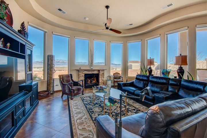 Open Sunday , 8/25 from 1:00 to 3:00 PMEnjoy breathtaking Sandia Mountain views from an expansive curvilinear window wall(over 30 ft.) running across the rear of this warm, inviting and highly upgraded Sky View /Scott Patrick home built on one of the largest lots in this custom area. This is clearly a unique home featuring a private, gated entry courtyard with video doorbell, upgraded tile, solid core wood doors, custom painted walls, upgraded interior & exterior light fixtures, upgraded ceiling fans, seamless MBR Bath shower door, stainless steel kitchen appliances including Bosch ovens with built-in exhaust fan venting to outside, 2 dishwashers, granite kitchen surfaces, pendant lighting & more. See MORE