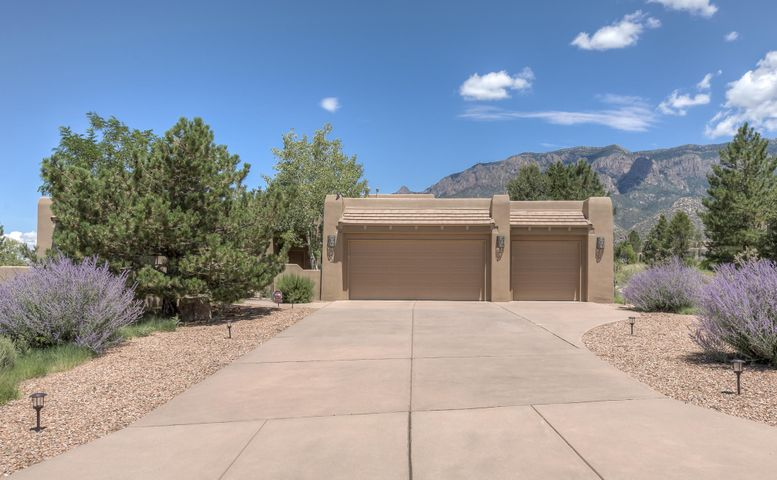 Welcome to premier High Desert living. You must see the awesome mountain views from this former Scott Patrick model home to appreciate. A wall of windows keep the open, spacious, flowing floorplan light and bright, while allowing you to enjoy the beauty of mother nature in comfort. Kitchen features  granite countertop, custom cabinets, bar seating and dining nook.  Separated master bedroom. Architectual features and skylights throughout. Large patio with flagstone, kiva fireplace and banco seating, water feature, plus a rooftop deck makes a great space for outdoor entertaining, watching spetacular sunsets, or maybe just catching of glimpse of deer foraging nearby. Low maintence water saving landscaping a plus for travelers. This single story, one owner home has been lovely cared for.
