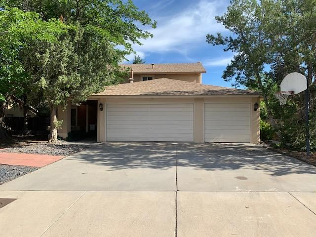 Open floor plan, two story home with new carpet and fresh paint through out.All bedrooms located upstairs, with a very large master bedroom. Down stairs has 2 living areas, one with a fireplace and wet bar. Very large backyard. Fruit trees in front and back. Three car garage