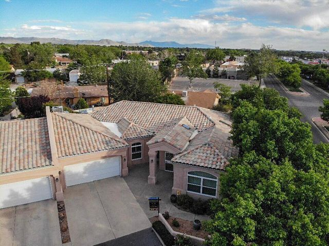 Fabulous upgraded Townhome in Bear Canyon Compound. This home is bathed in light, all the windows were replaced in 2016, it offers 3 bedrooms, & an office area, porcelain tile throughout the home. Refrigerated air, radiant floor heating in all areas except the 3rd bedroom which has baseboard heat. Beautiful Chef's kitchen with custom cherry cabinetry, soft close drawers, pull-outs galore, stainless appliances and tons of storage! Custom gas fireplace with a thermostat & fan, several skylights, ceiling fans, & newer recessed lighting. The full guest bathroom has a jetted tub & granite vanity, the master bathroom has a large walk in tiled shower with a bench and multiple shower heads & huge closet w/built in shelving & washer/dryer hookups. 8 hand carved doors & central vacuum!