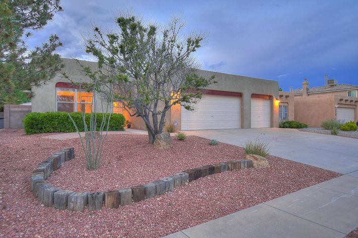Southwest style home within close proximity of Petroglyph Park!  Cozy up next to your Kiva fireplace in your large great room highlighted by soaring ceilings with wood vigas. This home features a spacious kitchen with updated granite counter-tops and stainless steel appliances, skylights and tile flooring. Outside you will find 2 additional covered patios off of the living & dining areas that open to an awesome backyard . Over sized 3 car garage w/ openers. Great Westside location close to Paseo Del Norte for easy commute. A modernized home with traditional New Mexican tastes. Schedule an appointment today!