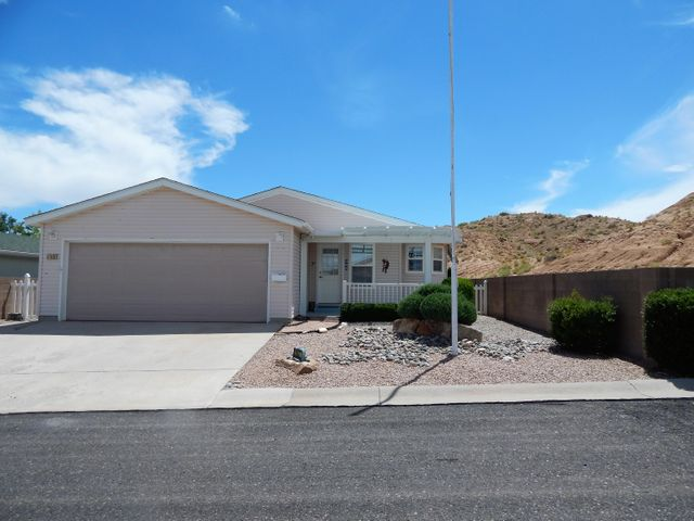 Beautiful home located in Sunrise Bluffs 55+ community.  Large home on private street with end location.  Home features large kitchen with upgraded appliances, pull-out lower cabinets, 3-rack electric range, newer refrigerator, island w/power and water softener.  Master Suite has walk-in shower with bench and double sinks with one raised.  Sunroom off Master Suite is insulated.  Guest bedroom is spacious with Murphy bed which will stay. Home has cellular shades throughout.  Garage is insulated and finished w/auto opener. Very low maintenance yard with auto drip for landscaping. Insulated front patio cover for quiet outdoor entertaining.  Gated community offers club house with year-round pool, exercise room, kitchen & dining area for parties.  Easy access to I-25 & minutes to Albuquerque.