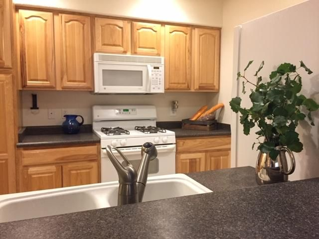 Located in the most private area of Oso Park. Wonderful 3 bedroom McClintock home with spacious floor plan. REFRIGERATED air! Large great room with gas log fireplace. Large wall mural by gifted artist. Big kitchen with GAS range for all you chefs. Huge master with big closet. JACUZZI tub in hall bath, plus double sinks. Secluded patio. Relax & enjoy life -- no yard work ever. Lots of guest parking across the street. HOA covers water, sewer & trash bills. Plus gate maintenance, exterior stucco, roof, landscaping, insurance & more. Deep, one-car garage. Large park across Morris. Great mountain views. Walk to CNM, El Patron & DION's Pizza!