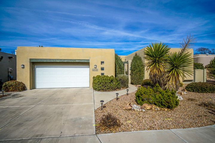 Welcome to luxury in the Near North Valley! Located on a quiet cul-de-sac close to the Coop, this home has xeriscaped front yard, lg entry, elegant finishes, & multi-channel sound system inside & out. Kitchen includes sky lights, lots of cabinets, a lg center island w storage and kitchen counter built in microwave, oven, gas stove top & dishwasher. Lg living rm w gas fireplace has nichos for displaying treasures and lg sliding door to a partially covered, private and low maintenance back patio with fans. Lg master suite w gas fireplace opens to the back patio & lg bathroom w jetted tub & separate shower, & huge closet, 2nd bathroom w/ lg shower serves 2 bdrms on the other wing of the house. 3rd bdrm/office has separate entrance to interior courtyard to allow for separate activity.