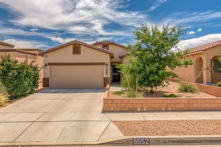 This Build Green NM Silver certified home offers peace of mind with Tile Roofing, Open concept Greatroom/kitchen, raised ceilings, Granite counters, stone tile backsplash, breakfast bar, Birch cabinet package, tile in all wet areas, 2'' blinds, ceiling fans, canned lights, and accented Lit nicho. The Master suite is private from the other 2 bedrooms equipped with Dual sinks, garden tub, separate shower, large walk in closet. Main components include Refrigerated air, tankless water heater. The Covered patio opens to the Low maintenance landscaped backyard with shed. NO PID. Taexx pest control in walls