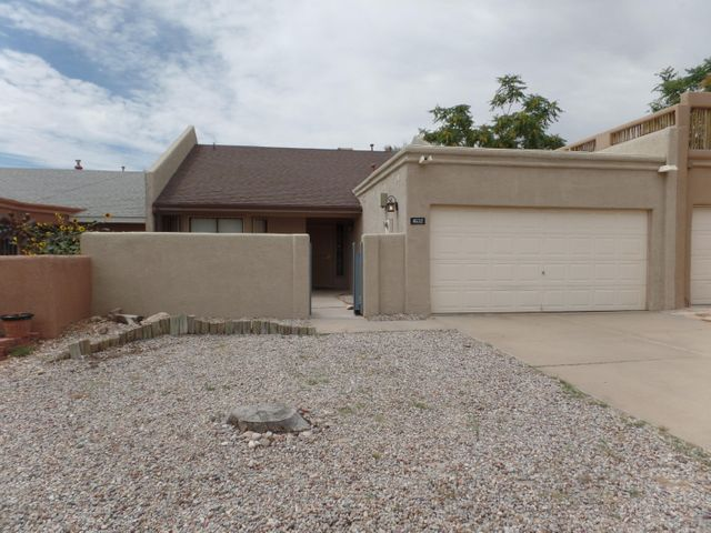 ''JUST LIKE NEW AND READY FOR YOU!''A CUTE AND CLEAN UPGRADED TOWNHOUSE.VERY CONVENIENT AND QUIET NEIGHBORHOOD ON WESTSIDE NEAR PASEO AND COORS.IDEAL FOR STARTER HOME OR RETIREES.PRIVATE BACK YARD AND GREAT NEIGHBORS.NICEST HOME IN THIS PRICE RANGE.MAY CONSIDER OWNER FINANCING (REC) WITH SUBSTANTIAL DOWN PAYMENT.  THIS WOULD BE GREAT RENTAL PROPERTY !!!
