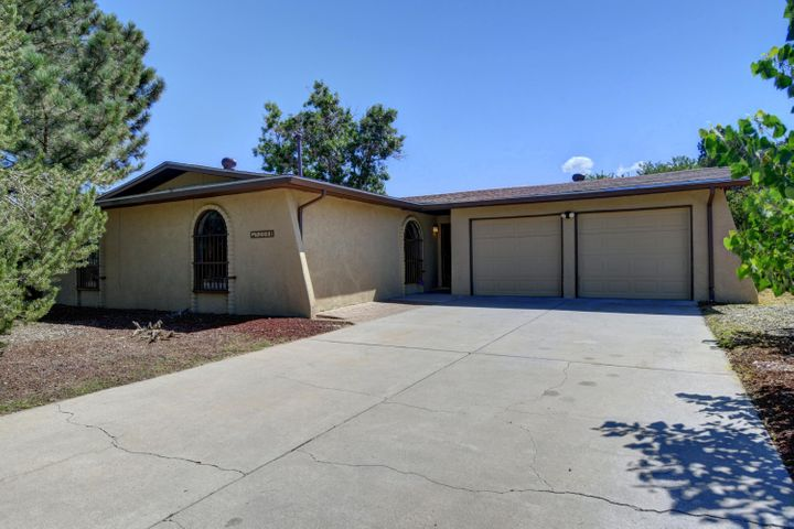 This lovely one story 3 bedroom home in a terrific location - close to stores, restaurants, I25 access - is updated and move-in ready - to include flooring, paint, fixtures, stainless steel appliances in kitchen, cabinets, bathrooms (mirrors, vanity in master, lighting), ceiling fans, re-plumbed also - you won't want to miss taking a look.  Spacious kitchen with tons of cabinet and counter space, nook area, large back yard to make your own, some views of the Sandias, shed for storage,  uncovered patio for dining, garage has space for work bench, and home also features a new roof installed July 2019.  Comfortable great room with wood burning fireplace.  Come and see and fall in love.