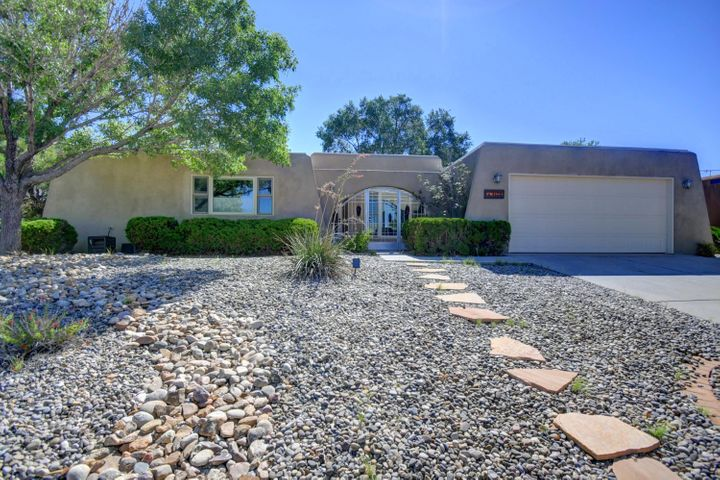 Location, location, location! This move-in ready NE HEIGHTS home offers 2 living areas with raised ceilings, a formal dining room, breakfast nook, separate service/laundry room with additional cabinets and counter top, open kitchen with stainless steel appliances, and walk in master closet. Recent updates include: Roof installed 2014, new stucco 2018, fresh paint 2019, Aerocool evaporative cooler & furnace installed 2014, 50 gal water heater installed 2015, new dishwasher installed 2019, Pella triple pane windows throughout, and a custom closet organizer installed in bedroom. The very well maintained, three tier backyard has all the space and privacy you need with a covered patio, large trees, two large finished sheds, green grass and flowers throughout. You don't want to miss this one!