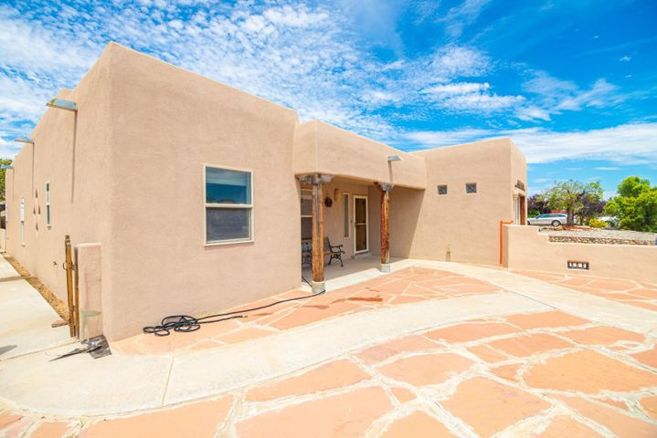 Location, location, location.  Beautiful custom home on almost 1/2 acre lot.  2,501 sq ft, 4 bedrooms plus an office, 2-1/2 baths.  New roof in 2019.  Refrigerated air conditioning.  3-car attached garage and 2-car detached garage with lots of backyard access for additional vehicles.  Easy access to I-25 and minutes to Albuquerque.  Close to all City conveniences.