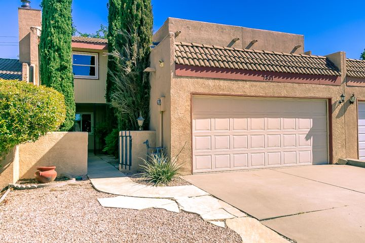 Welcome to turn-key 7331 Prairie Rd NE, a remarkably livable, thoughtfully designed, spacious 3 bed, 2.5 bath Tierra Encantada townhouse w/ attached 2 car garage. Ground floor features large living room w/ vaulted ceiling & gas log fireplace, modern & functional kitchen w/ pantry, powder room, designated laundry room, & garage w/ secure interior home access. Recent kitchen remodel creates an open living to kitchen floor plan w/ sleek, contemporary bright white cabinetry. 2nd floor offers sizable master bedroom, master bath w/ soaking tub, separate shower & 2 sinks, 2 large additional bedrooms, sizable hallway bathroom, skylights, & beautiful upper level views. Bathroom cabs re-done to match kitchen. Centrally located in a quiet neighborhood, less than 1 block from Novella Park, and no HOA!